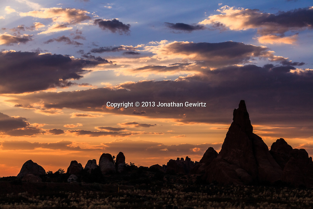 Silhouetted rock formations at sunset in Arches National Park, Utah. WATERMARKS WILL NOT APPEAR ON PRINTS OR LICENSED IMAGES.