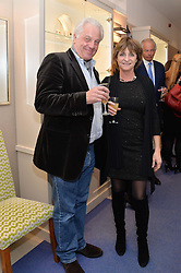 JEREMY WALSH and PRINCESS EMMA GALITZINE at a preview of the latest collections by jewellery designer Kiki Mcdonough and fashion label Beulah held at Kiki McDonough Jewellery, 12 Symons Street, London on 5th March 2014.