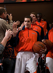 Virginia guard Sammy Zeglinski (13) leads the team through the student section before the VT game.  The Virginia Cavaliers defeated the Virginia Tech Hokies 75-61 at the John Paul Jones Arena on the Grounds of the University of Virginia in Charlottesville, VA on February 18, 2009.