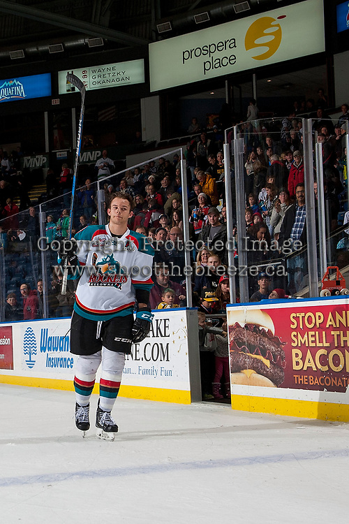 KELOWNA, CANADA - JANUARY 3: Carsen Twarynski #18 of the Kelowna Rockets raises his stick to fans to accept the first star of the game against the Tri-City Americans on January 3, 2017 at Prospera Place in Kelowna, British Columbia, Canada.  (Photo by Marissa Baecker/Shoot the Breeze)  *** Local Caption ***