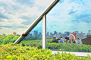 Metropolitan Museum of Art Roof Garden view of Manhattan, partly reflected in mirrored windows wall, at 5th Avenue and E 81st Street, New York City, NY, USA, on July 2011.