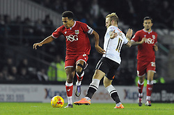 Korey Smith of Bristol City passes Johnny Russell of Derby County - Mandatory byline: Dougie Allward/JMP - 15/12/2015 - Football - iPro Stadium - Derby, England - Derby County v Bristol City - Sky Bet Championship