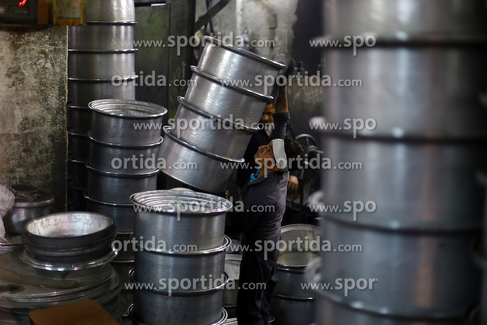 An Egyptian worker makes aluminous cooking pots at a local factory in Mit Ghamr of Dakahlia, 150 km north of Cairo, Egypt, on March 13, 2016. There are about 1,500 aluminous product factories in Mit Ghamr with over 80,000 workers employed. These factories produce over 80% of Egypt's domestic aluminous products and many of the products are exported to other African countries. EXPA Pictures &copy; 2016, PhotoCredit: EXPA/ Photoshot/ Ahmed Gomaa<br /> <br /> *****ATTENTION - for AUT, SLO, CRO, SRB, BIH, MAZ, SUI only*****