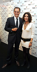 ANTOINE PIN and actress NEVE CAMPBELL at the TAG Heuer British Formula 1 Party at the Mall Galleries, London on 15th September 2008.