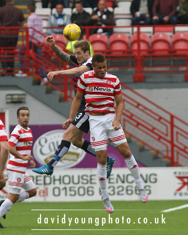 Dundee&rsquo;s Kevin Holt outjumps Hamilton Academical's Carlton Morris - Hamilton Academical v Dundee, Ladbrokes Premiership at New Douglas Park<br /> <br /> <br />  - &copy; David Young - www.davidyoungphoto.co.uk - email: davidyoungphoto@gmail.com