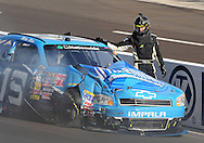 Nov. 12 2011; Avondale, AZ, USA; NASCAR Nationwide Series driver Mike Bliss (19) stands on the track next to his crashed car during the Wypall 200 at Phoenix International Raceway. Mandatory Credit: Jennifer Stewart-US PRESSWIRE