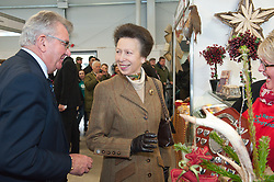 © Licensed to London News Pictures. 02/12/2014. Llanelwedd, UK. Princess Anne visits the Royal Welsh Winter Fair for the first time. Along with several other members of the royal family, Princess Anne has supported the Royal Welsh Showground Society's events and visited the Royal Welsh Show in 1981. The Royal Welsh Winter Fair is celebrating it's 25th anniversary. Photo credit: Graham M. Lawrence/LNP