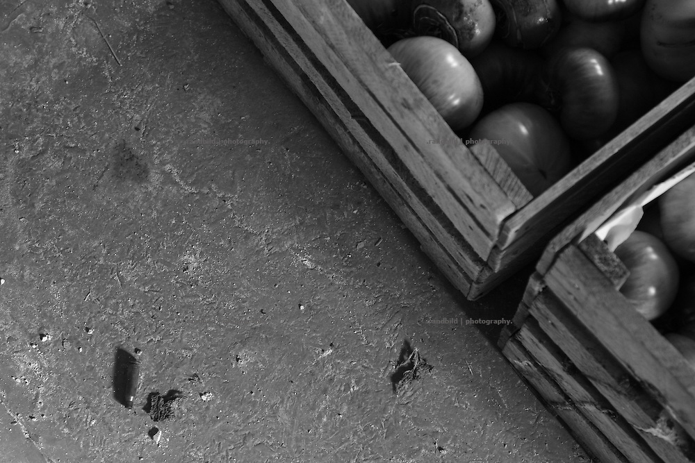 A cartridge lies on the floor beside boxes of the recently tomato harvest in the frontline village Dizi. Dizi is located in the so called bufferzone between Gori and Tskhinvali, few days after the withdrawal of the russian forces from the area. The bufferzone was etablished after a short war in August 2008 as the georgian army assulted South Ossetia to overthrow the local separatist government.