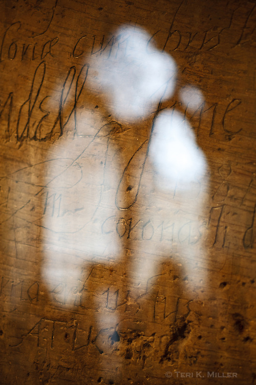 Graffiti from prisoners across the centuries litters the walls at the Tower of London, London, England.
