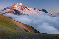 Clouds dissipating in the evening light around Mount Baker (elevation 10,778 feet (3,285 m). Seen from Chowder Ridge, Mount Baker Wilderness Washington USA