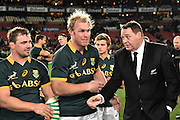 JOHANNESBURG, South Africa, 25 July 2015 : Coach of the All Blacks, Steve Hanson congratulates the Springboks, Heinrich Brussow and Schalk Burger (C) after the Castle Lager Rugby Championship test match between SOUTH AFRICA and NEW ZEALAND at Emirates Airline Park in Johannesburg, South Africa on 25 July 2015. Bokke 20 - 27 All Blacks<br /> <br /> © Anton de Villiers / SASPA