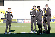 Members of the Wolves squad inspect the pitch and read the Burton Albion match day programme during the EFL Sky Bet Championship match between Burton Albion and Wolverhampton Wanderers at the Pirelli Stadium, Burton upon Trent, England on 4 February 2017. Photo by Richard Holmes.