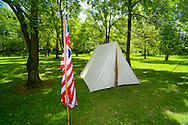 8/18/12 12:51:12 PM - Warwick, PA. -- A flag and a tent are seen during a revolutionary war reenactment at the Moland House August 18, 2012 in Warwick, Pennsylvania. -- (Photo by William Thomas Cain/Cain Images).