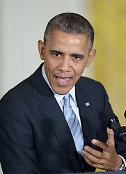 61056582<br /> U.S. President Barack Obama speaks before signing an executive order to raise the minimum wage for federal contract workers in the East Room of the White House in Washington D.C., the United States, Feb. 12, 2014. The move, first announced during the State of the Union address, will raise the minimum wage for federal contractors to 10.10 dollars per hour from the current rate of 7.25 dollars, Washington D.C., the United States, Wednesday, 12th February 2014. Picture by  imago / i-Images<br /> <br /> UK ONLY