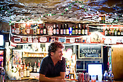 Mr. Mouse tends the bar at the Cave, in Chapel Hill.
