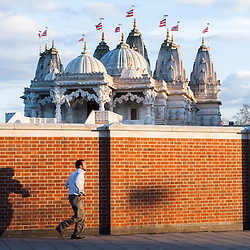 A man arrives at The BAPS Shri Swaminarayan Mandir, also referred to as Neasden Temple, before the celebrations of Swaminarayan Jayanti at Neasden Temple in London.