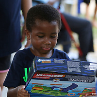 Laddaius Davis, 4, picks out a prize Saturday at the Back to School event at Veterans park