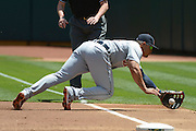 May 29, 2014; Oakland, CA, USA; Detroit Tigers first baseman Miguel Cabrera (24) dives after a foul ball against the Oakland Athletics during the first inning at O.co Coliseum.