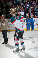 KELOWNA, CANADA - MAY 13: Lucas Johansen #7 of Kelowna Rockets skates with the WHL Championship trophy on May 13, 2015 during game 4 of the WHL final series at Prospera Place in Kelowna, British Columbia, Canada.  (Photo by Marissa Baecker/Shoot the Breeze)  *** Local Caption *** Lucas Johansen