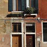 Italy, Veneto, Venice. November/12/2007...Pattern and colors at play in the facade of apartment building in Venice, Italy..