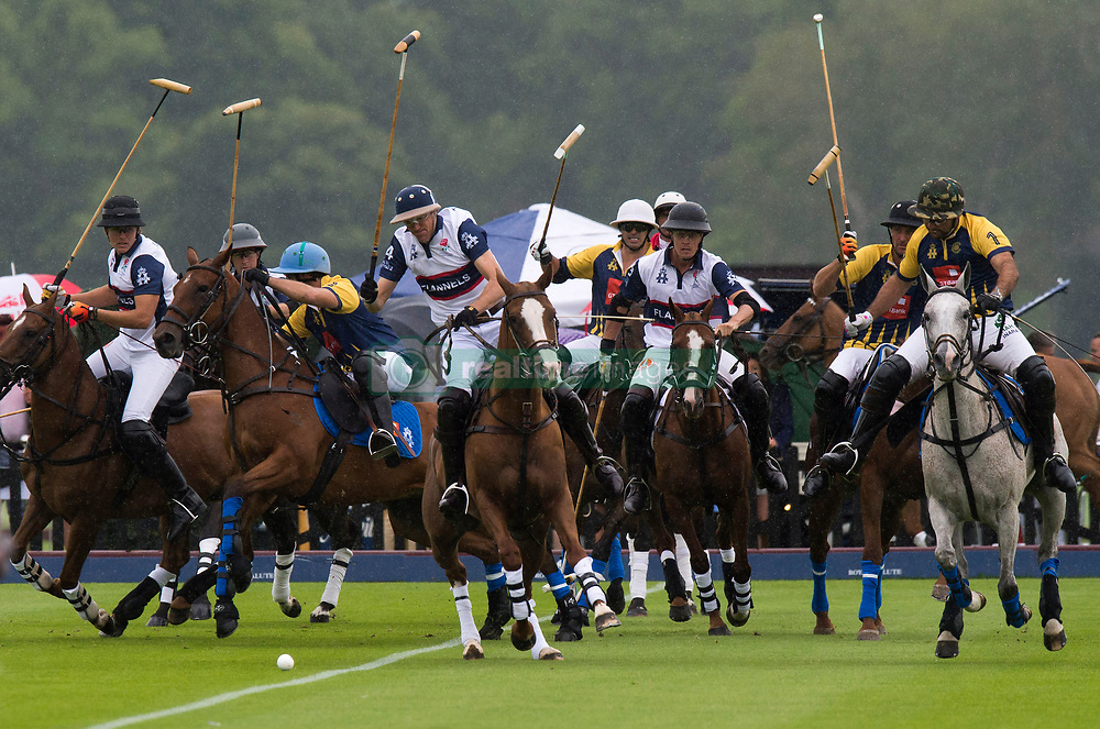 England, in white, and Commonwealth polo players during the Royal Salute Coronation Cup polo at Windsor Great Park in Surrey.
