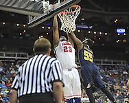 Ole Miss' Reginald Buckner (23) is fouled by La Salle's Ramon Galloway (55) in the Round of 32 of the NCAA Tournament at the Sprint Center in Kansas City, Mo. on Sunday, March 24, 2013. La Salle won 76-74.