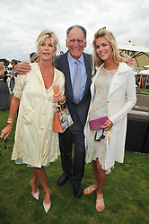 BARON TEDDY VAN ZUYLEN, his former wife BEE VAN ZUYLEN and their daughter ALLEGRA VAN ZUYLEN at the 25th annual Cartier International Polo held at Guards Polo Club, Great Windsor Park, Berkshire on 26th July 2009.