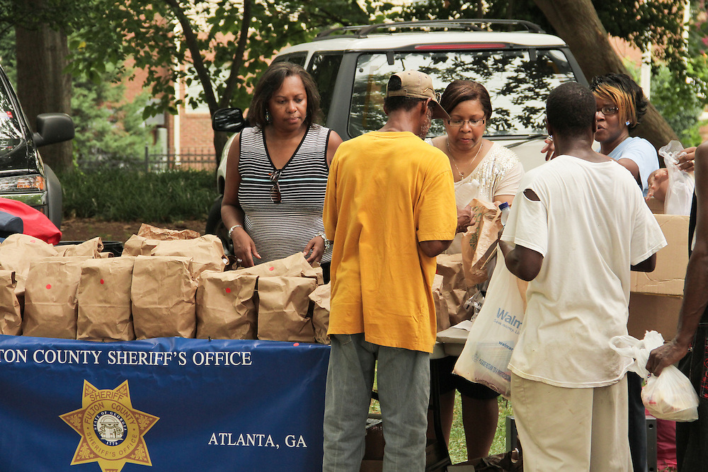 Two and a half hours is all it took for the Fulton County sheriff's department to run out of food. It was not because they were ill-prepared, it was they had almost doubled their expectations in half the time. The sheriff's office planned to have enough food and supplies to hand out to about 300 members of Atlanta's homeless population. By 1:30 p.m. they had already served 375, with more in line. But that didn't spoil the attitudes of the volunteers. &quot;I love people. I'll do anything to help people,&quot; said Willie, one of the volunteers and a local chaplain who has been homeless himself and knows how welcoming help like this is to those in a rough situation.<br /> <br /> The event, which was set to be held from 11 a.m. to 4 p.m. in Renaissance Park, was part of a yearly community outreach program by the Fulton County sheriff's department to help combat some of Atlanta's largest issues with compassion rather than force. Lieutenant Bryan McGee who spearheaded the event wanted to make sure that Atlanta's homeless did not feel forgotten by the city. The sheriff's department uses events like this one to show the &quot;softer&quot; side of the law and help combat some of the stereotypes that are perpetuated throughout the community.