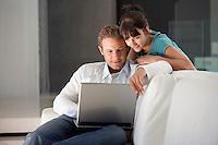 Young couple using laptop portrait