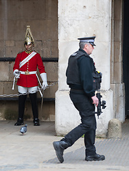 © Licensed to London News Pictures . 27/03/2017 . London , UK . An armed police officer patrols Horse Guards Parade in Westminster following to Khalid Masood's terrorist attack and the killing of PC Keith Palmer . Photo credit: Joel Goodman/LNP