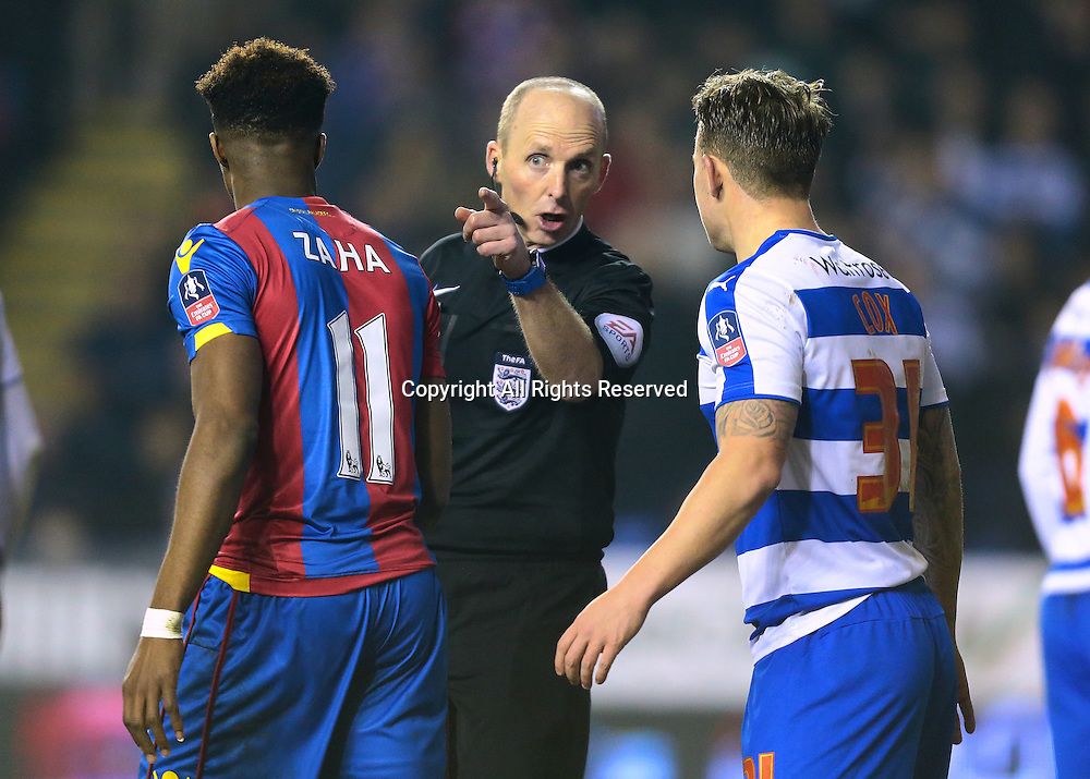 11.03.2016. Madejeski Stadium, Reading, England. Emirates FA Cup 6th Round. Reading versus Crystal Palace. Referee Mike Dean gives Reading Forward Simon Cox a warning after a rough challenge