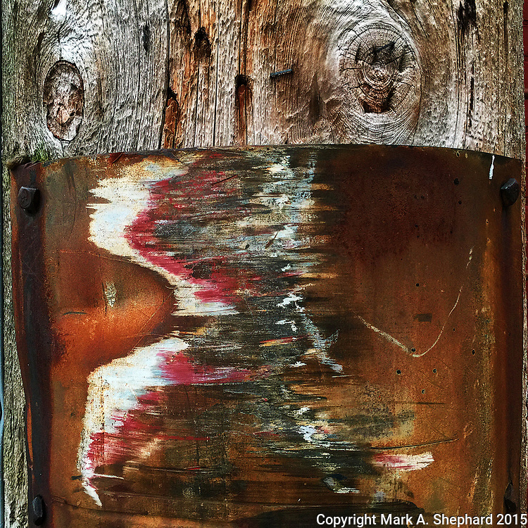 Delivery trucks have helped create abstract art on this utility pole in the alley next to the Electric Brew in Goshen, Indiana. (iPhone 6Plus Photo by Mark A. Shephard)