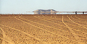 Bayuda Desert, Sudan-- June 20, 2004    Tire tracks criss cross the Bayuda Desert as a mirage in the horizon tricks the traveler into believing the presence of water. photo by essdras m suarez/globe staff      Library Tag 10312004  Travel