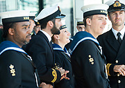 Some members of the navy wait for the ceremony to begin <br /> <br /> Armed Forces Day - City Hall ceremony pays tribute to British Armed Forces, London, Great Britain 25th June 2018 <br />  <br /> The Mayor of London and the London Assembly joined members of the British Armed Forces at City Hall today for a flag-raising ceremony to honour the courage and commitment of the Armed Forces community.<br /> The annual ceremony took place ahead of National Armed Forces Day, next Saturday, and was attended by members of the Forces as well as veterans, reserves, cadets and representatives from military charities. It is the 10th Armed Forces Day ceremony organised by the Mayor and London Assembly.<br /> <br /> The Mayor, Sadiq Khan and Chair of the London Assembly, Tony Arbour AM, joined senior military figures for the ceremony, which featured musical contributions from the Band of the Royal Yeomanry.<br />  <br /> Naval Commodore David Elford OBE, Army Colonel Victor Matthews OBE and Air Commodore David Prowse OBE from the Royal Air Force offered a joint military response.<br /> The Armed Forces flag was raised by Cadet Cpl Aaron Harmsworth and Cadet Charlotte McCarthy.<br /> <br /> Photograph by Elliott Franks