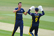 Kyle Abbott and Tom Alsop of Hampshire celebrate the wicket of Paul Stirling during the Royal London One Day Cup match between Hampshire County Cricket Club and Middlesex County Cricket Club at the Ageas Bowl, Southampton, United Kingdom on 23 April 2019.