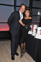JOAN COLLINS and PERCY GIBSON at a party to celebrate the publication of her  autobiography - The World According to Joan, held at the British Film Institute, South Bank, London SE1 on 8th September 2011.