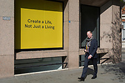 A create a life, not just for living slogan outside offices in the City of London, the capital's financial district, on 1st April, 2019, in London England.