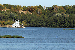 11 October 2015:   A tug boat heads up the Illinois River near Mayo Island between Utica and Ottawa without any barges..  Scenics from along the Illinois River Scenic Road and sites along the drive.  All images were between Ottawa and East Peoria.<br /> <br /> This image was produced in part utilizing High Dynamic Range (HDR) processes.  It should not be used editorially without being listed as an illustration or with a disclaimer.  It may or may not be an accurate representation of the scene as originally photographed and the finished image is the creation of the photographer.