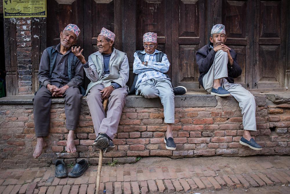 Old friends relaxing in Bhaktapur, Nepal.<br /> Photo by Lorenz Berna