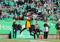 Nov 25, 2017; Huntington, WV, USA; Southern Miss Golden Eagles wide receiver Korey Robertson (18) and Marshall Thundering Herd defensive back Rodney Allen (11) jump for a pass in the end zone during the third quarter at Joan C. Edwards Stadium. Mandatory Credit: Ben Queen-USA TODAY Sports