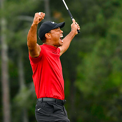 Apr 14, 2019; Augusta, GA, USA; Tiger Woods celebrates after making a putt on the 18th green to win The Masters golf tournament at Augusta National Golf Club. Photo : Michael Madrid / SUSA / Icon Sport