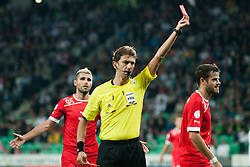 Referee Paolo Tagliavento shows red card to Tranquillo Barnetta of Switzerland during qualification football match for World Cup 2014 in Brazil between national team of Slovenia and Switzerland, on September 7, 2012 in Ljubljana, Slovenia. (Photo by Matic Klansek Velej / Sportida.com)