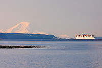 Mount Rainier from Ebeys Landing Whidbey Island Containership passing through Admiralty Inlet Washington USA