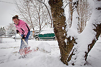 Angie Asbury shovels snow from her grandparents driveway on Orchard Avenue in Hayden during a lull in the snow storm Monday.