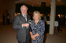 SIR TIMOTHY & LADY CLIFFORD at the private preview of Masterpiece 2015 held at the Royal Hospital Chelsea, London on 24th June 2015.