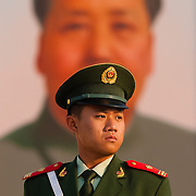 Guard in front of a painting of Mao Tse Tung, Tien An Men square, Beijing, China
