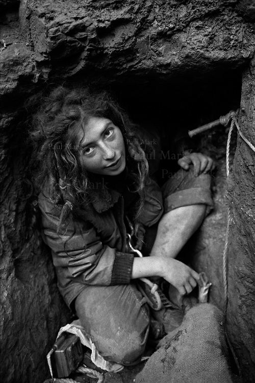 """Nadine, a protester at the humorously named """"Sir Cliff Richard OBE Vegan Revolution"""" camp, in the entrance to her tunnel. During the eviction it took bailiffs 72 hours to remover her from the tunnel."""