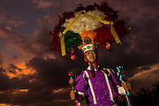 A traditional costumed folk dancer wearing a Zapotec warrior headdress poses at sunset during the Day of the Dead Festival known in spanish as Día de Muertos on October 29, 2014 in Oaxaca, Mexico.