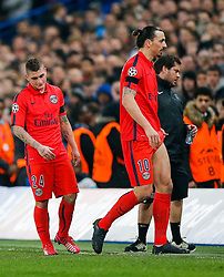 Marco Verratti looks dejected as Zlatan Ibrahimovic of Paris Saint-Germain leaves the pitch after he is shown a red card by referee Bjorn Kuipers - Photo mandatory by-line: Rogan Thomson/JMP - 07966 386802 - 11/03/2015 - SPORT - FOOTBALL - London, England - Stamford Bridge - Chelsea v Paris Saint-Germain - UEFA Champions League Round of 16 Second Leg.