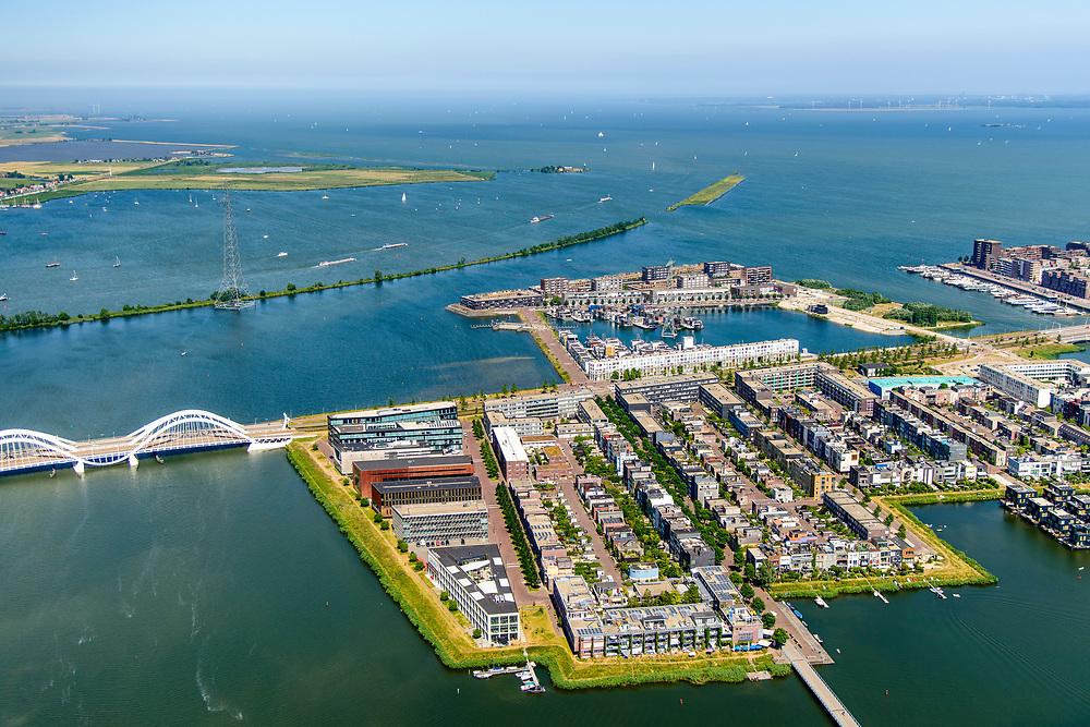Nederland, Noord-Holland, Amsterdam, 29-06-2018; IJburg, woonwijk aangelegd op kunstmatige - aangeplemte - eilanden. Steigereiland met zelfbouw kavels. Haveneiland geheel rechts. Buiten-IJ en IJmeer in de achtergrond<br /> IJburg, residential area built on artificial islands.<br /> luchtfoto (toeslag op standard tarieven);<br /> aerial photo (additional fee required);<br /> copyright foto/photo Siebe Swart
